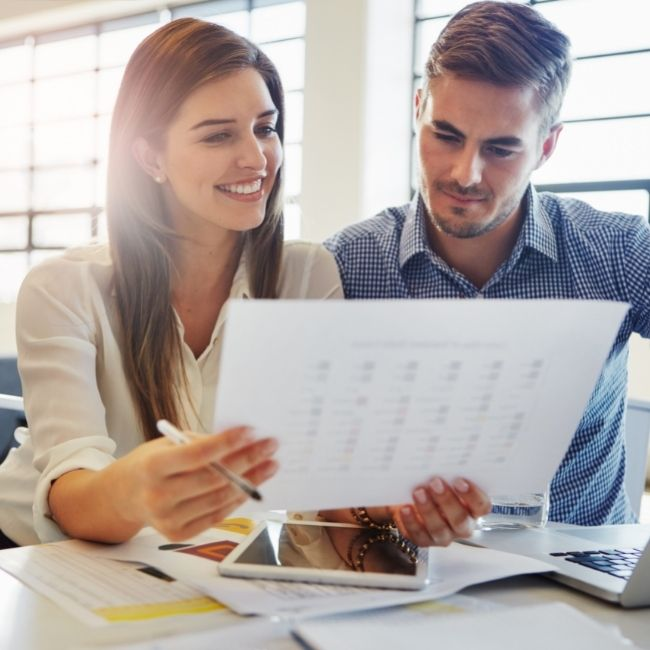 What is conveyancing? Image of a couple sitting at a table looking at paperwork